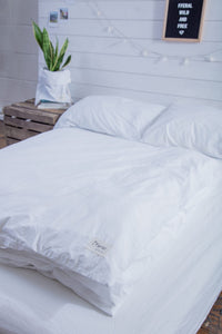 folded organic cotton duvet and pillowcases