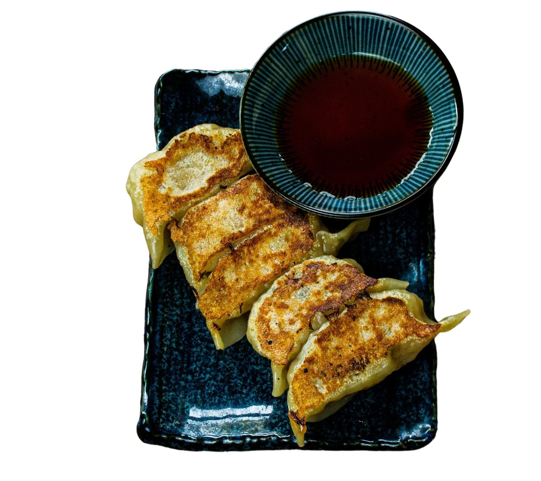 Fried gyoza with sauce on the side