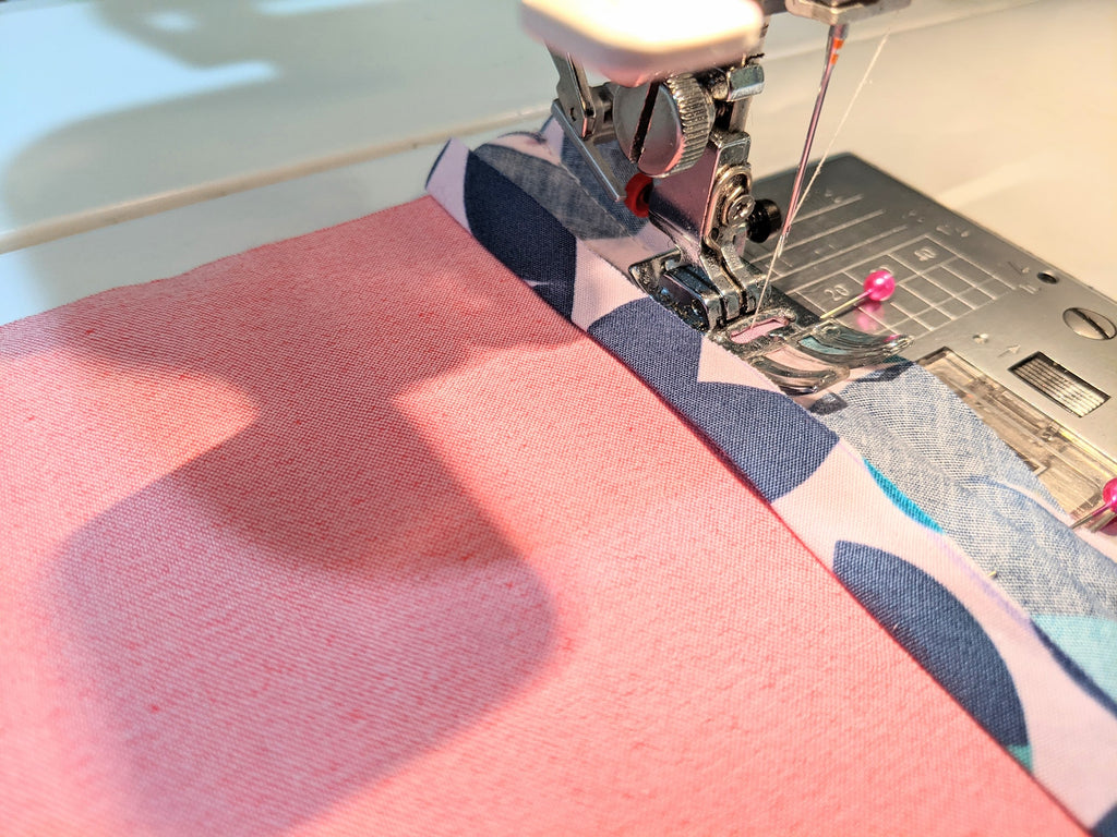 Sewing bias tape to seam, following the crease