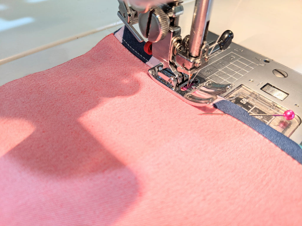 """Sewing bias tape 1/8"""" from sewn edge"""