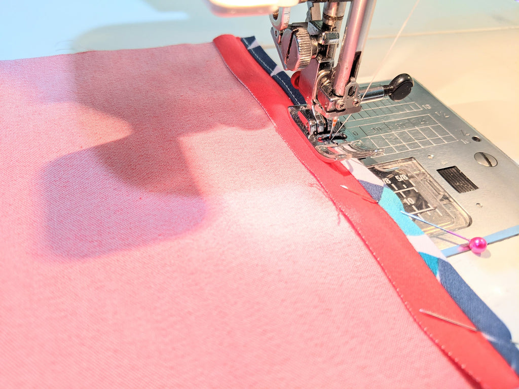 Wrap tape around the seam and sew 1-2mm from the sewn edge