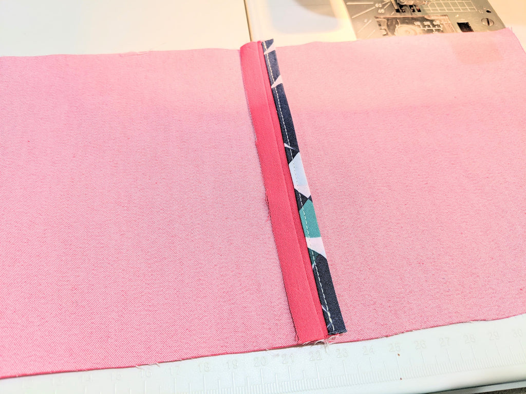 Finished binding on one side of the open seam