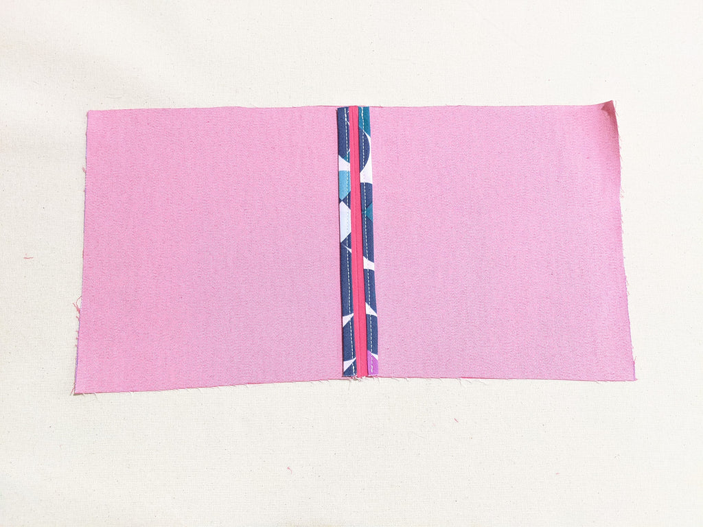 Finished binding on both sides of the open seam