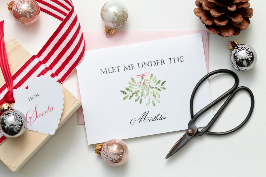 """Meet me under the mistletoe"" card"