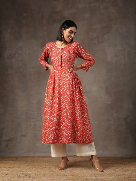 Red floral kurta with cream textured pants - Label Raasleela