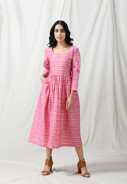 Soft pink ikat dress with dark pink applique