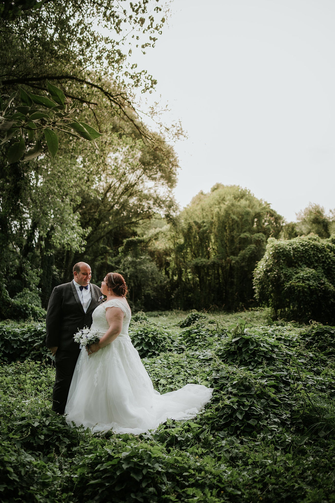bride and groom with new zealand greenery backdrop