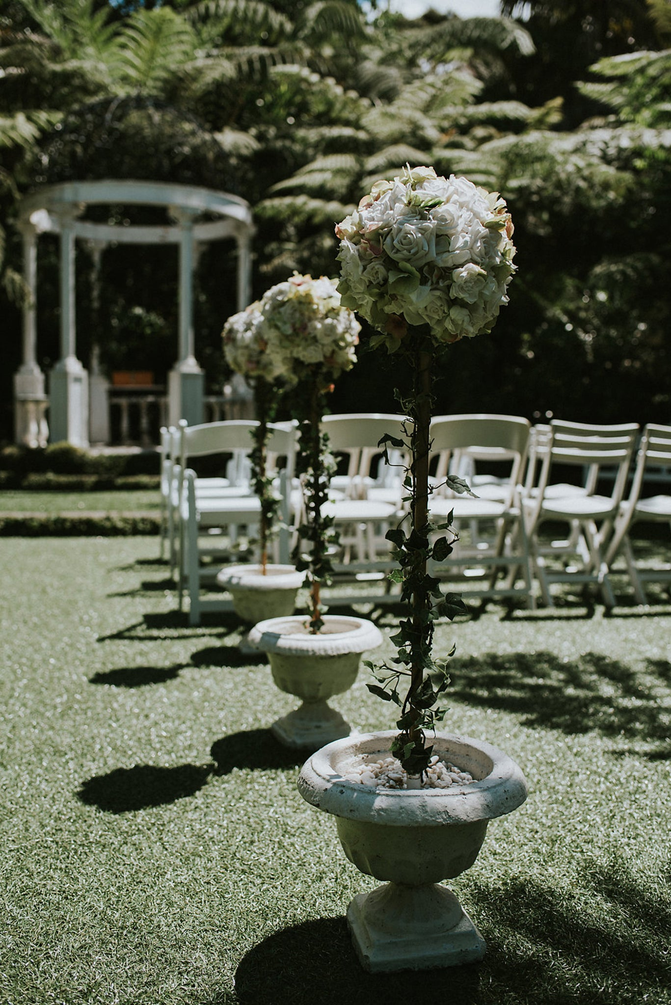 wedding ailse white flower decorations at a cassels wedding
