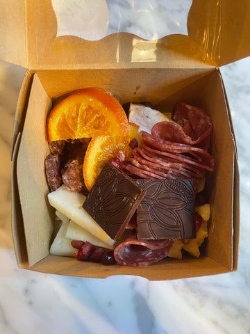 Laura B Steele Charcuterie Boxes available at the indi chocolate Holiday Pop-up contain ingredients from Seattle's favorite small businesses. From indi chocolate's bean to bar chocolate made in their Pike Place Market factory, Beecher's Cheese, Salt Blade Meats Seattle Stick Salami (made with indi chocolate cocoa nibs), Coro Foods Salami, and more. Come enjoy the best food that Seattle small businesses have to offer. Support small, women owned businesses in Seattle. Happy holidays and thank you for supporting small business.