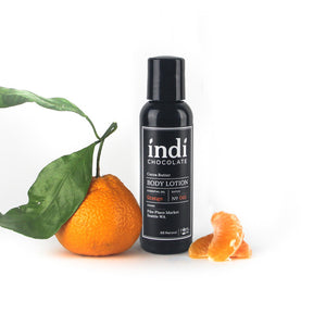 indi chocolate Orange Body Lotion -2 oz - Made with the same cocoa butter we use to make our bean to bar chocolate, this lotion is a real treat. Made with great ingredients, this lotion absorbs well without leaving a greasy residue. Great for everyone on your list, including you. Great for individual, corporate, holiday and gift giving.
