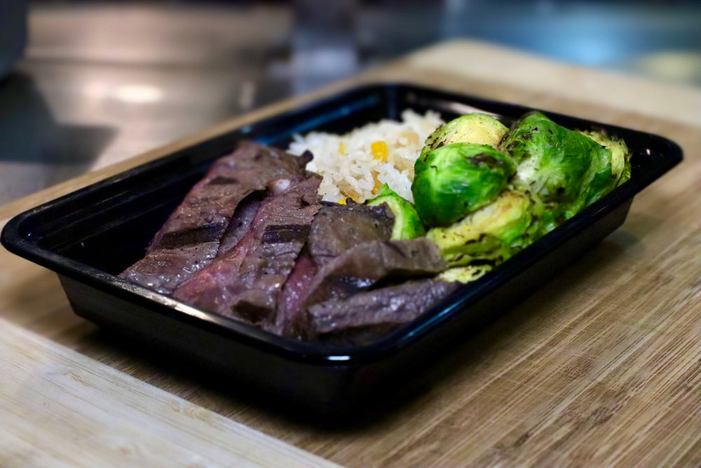 beef meal with rice and Brussels sprouts