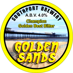 Golden Sands. A circular badge bordered in yellow. Southport Pier is shown in the background and the brewery name, beer name and ABV are displayed in the foreground.