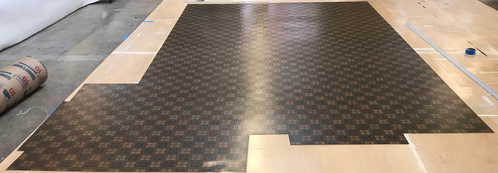 This shows the floorcloth cut to the size of the template.