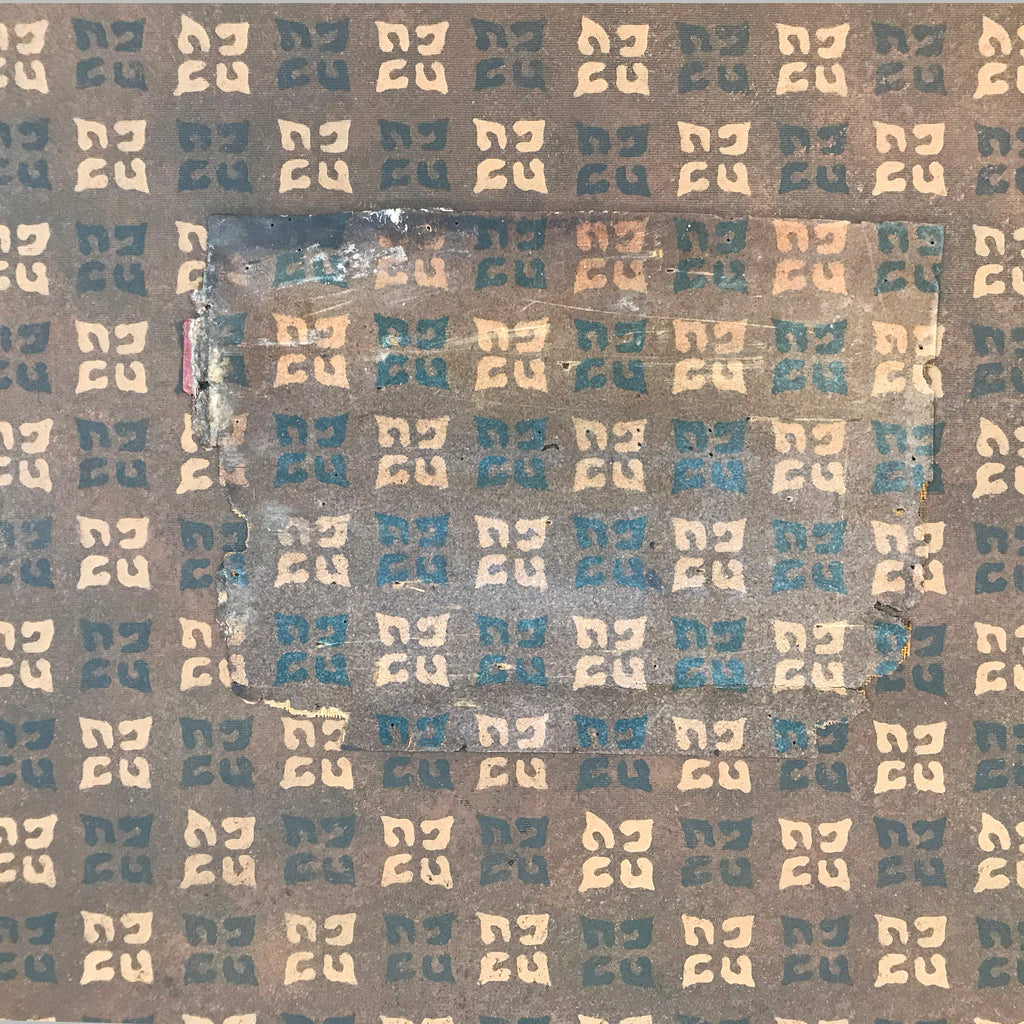 This image shows the floorcloth with the linoleum scrap laid on top for comparison purposes.