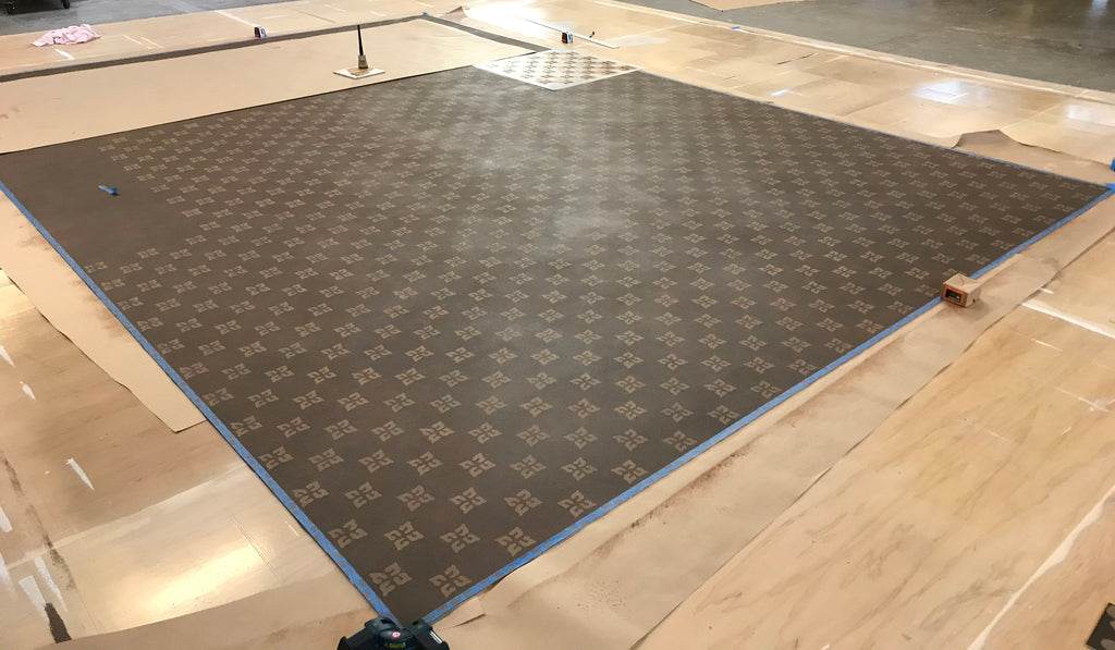 This image shows the floorcloth with the cream stencil pass almost complete.