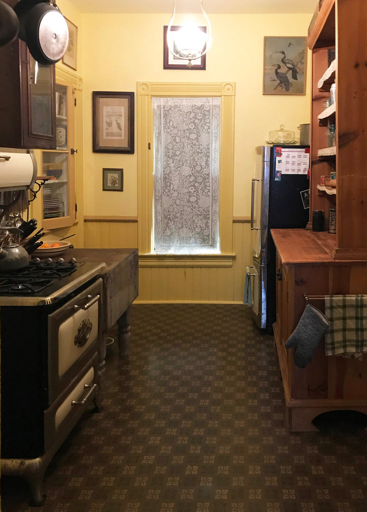 This shows the wall-to-wall floorcloth, based on an original linoleum pattern, c1910, installed in the kitchen with the appliances and furniture back in place.