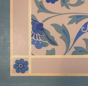 Close up image of floorcloth corner with an all over floral pattern, based on a Christopher Dresser pattern.