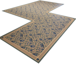 Load image into Gallery viewer, Full image of this shaped floorcloth with an all over floral pattern based on a Christopher Dresser pattern.