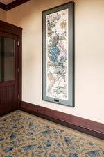 Load image into Gallery viewer, In-situ image of a shaped floorcloth, made to perfectly fit this space. The design is an all over floral pattern by Christopher Dresser. The Peacock is an original wallpaper panel c.1910 from Arthur Sanderson & Sons. Photo by Sally Painter.