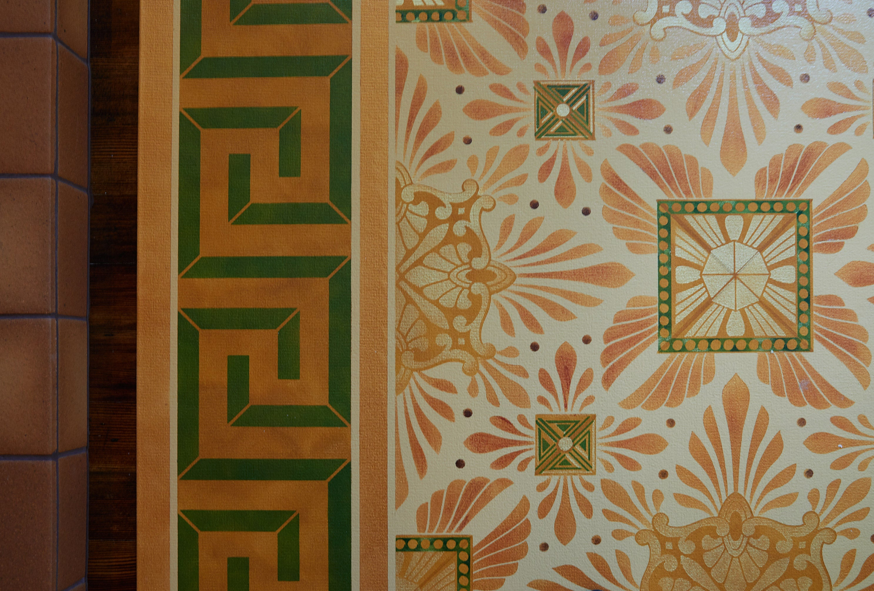 Close up of this floorcloth's deco center motifs, based on a design by Christopher Dresser.  The border employs a Greek Key design. Photo by Sally Painter.