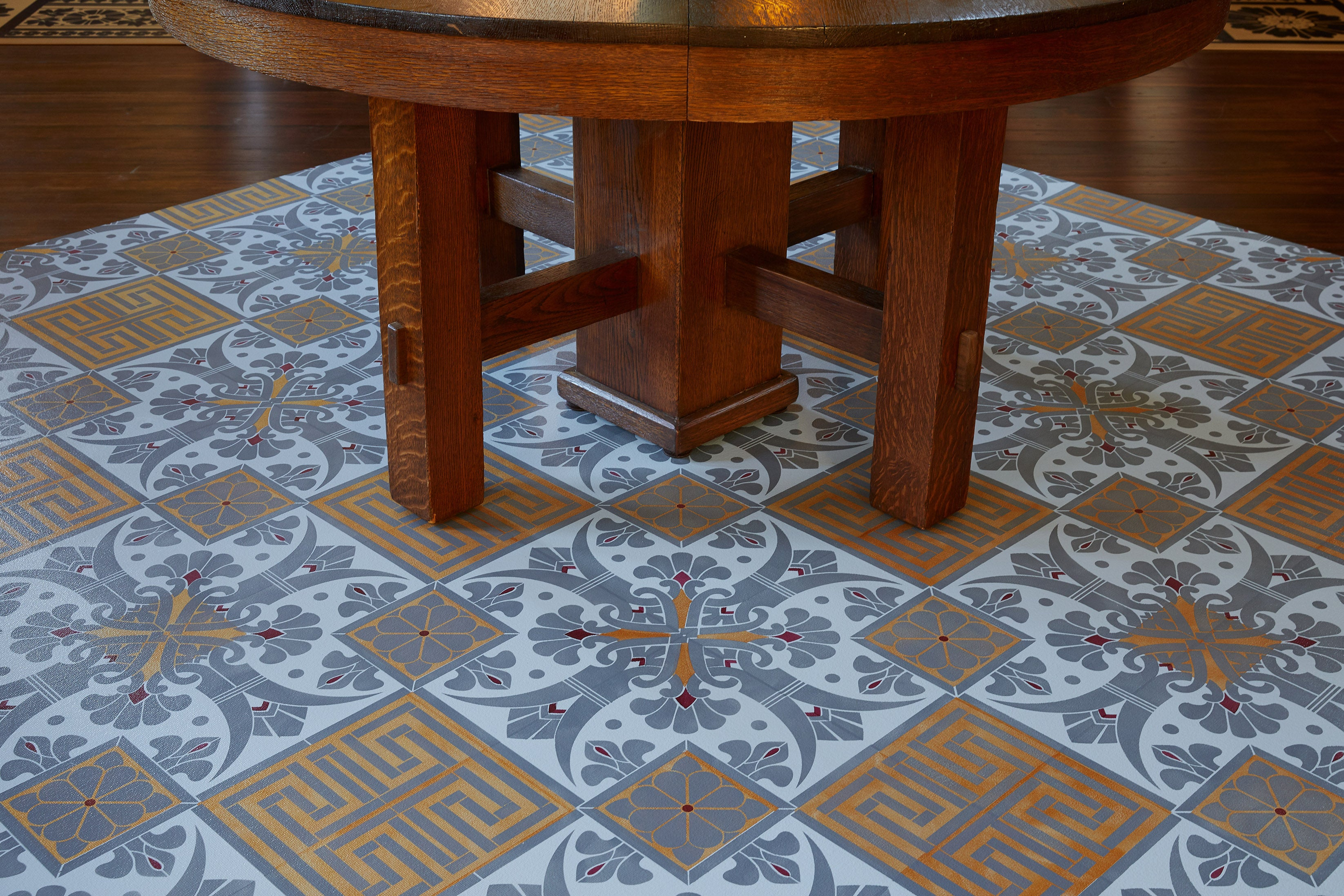 In-Situ image of this floocloth based on a Christopher Dresser pattern with Greek Key and Fleur de lis elements. Photo by Sally Painter.