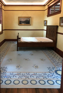 In-situ image of this floorcloth, the design of which is based on a ceiling pattern in the 1889 Robert Graves Co. Wallpaper Catalog.