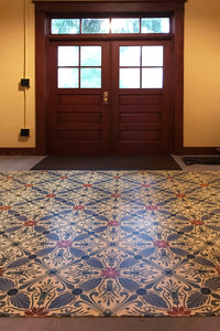 In-situ image of this floorcloth based on a Christopher Dresser design with  and overall diamond effect and deco elements.