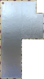 Load image into Gallery viewer, Backside of this shaped floorcloth showing waterproof fabric adhered to hem, with a layer of carpet padding underneath the fabric layer.