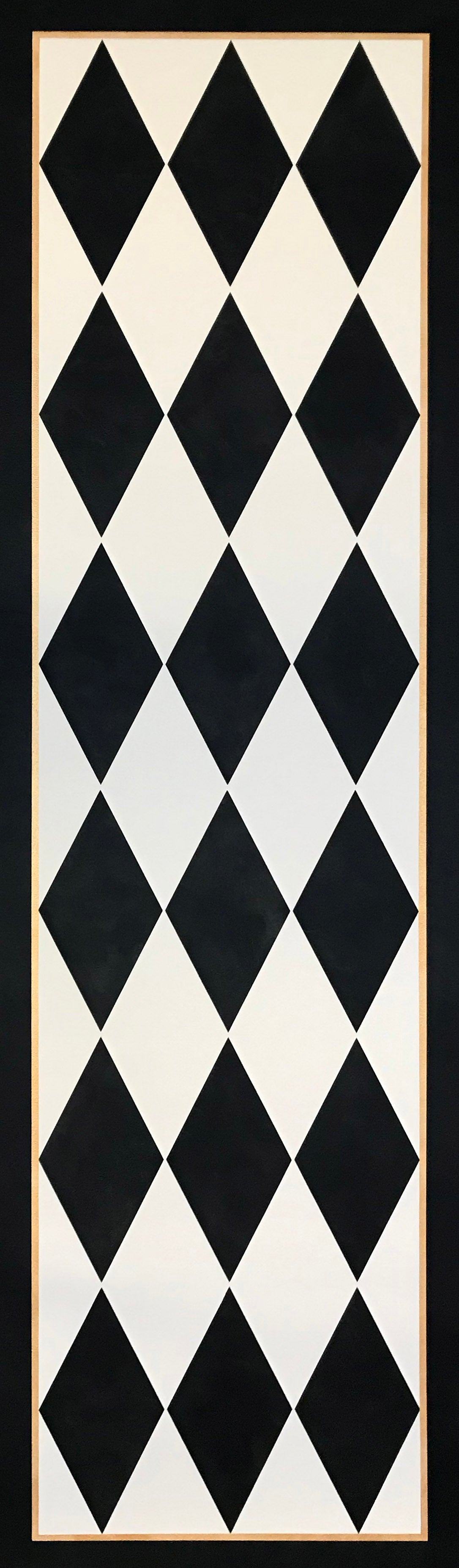 The full image of this traditional floorcloth which employs a classic harlequin pattern of elongated diamonds in cream and black.