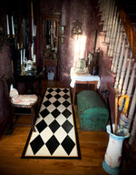 Load image into Gallery viewer, This Harlequin Floorcloth gracing the hall of this lovely 1880 home with its dramatic period wallpaper.