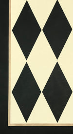 Load image into Gallery viewer, A close up image of this harlequin patterned floorcloth in a soft yellow-white and charcoal colorway.