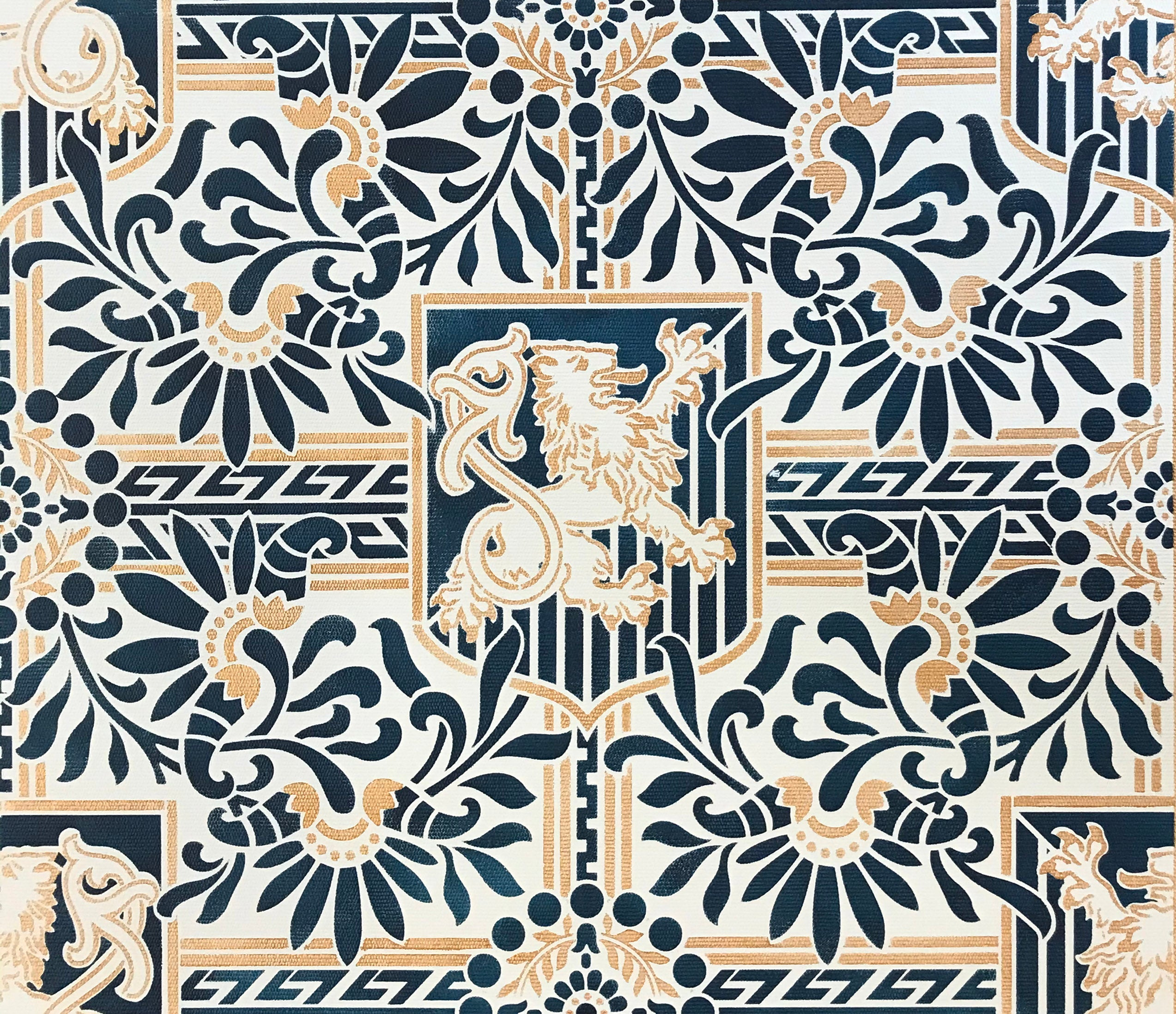 A close up of the pattern for this floorcloth featuring a lion in shield with floral and Greek Key elements.