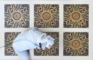 A full image of our Thistle Tile Floorcloth  with Opal providing scale.