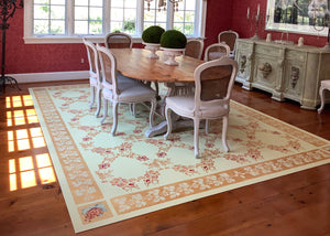 In-situ image of this custom floorcloth with the buffet that was the inspiration for its hand-painted corner motifs.