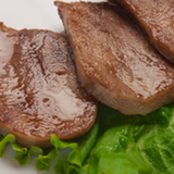 Creswick Farm's Small Beef Tongue Displayed With A Leaf Of Lettuce