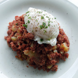 Creswick Farm's Corned Beef Hash Displayed With An Egg