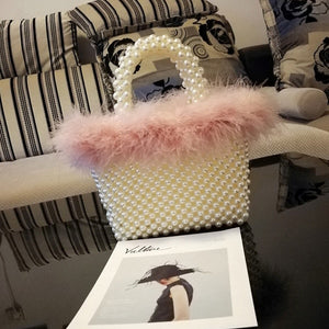 Pink feather and pearl bag