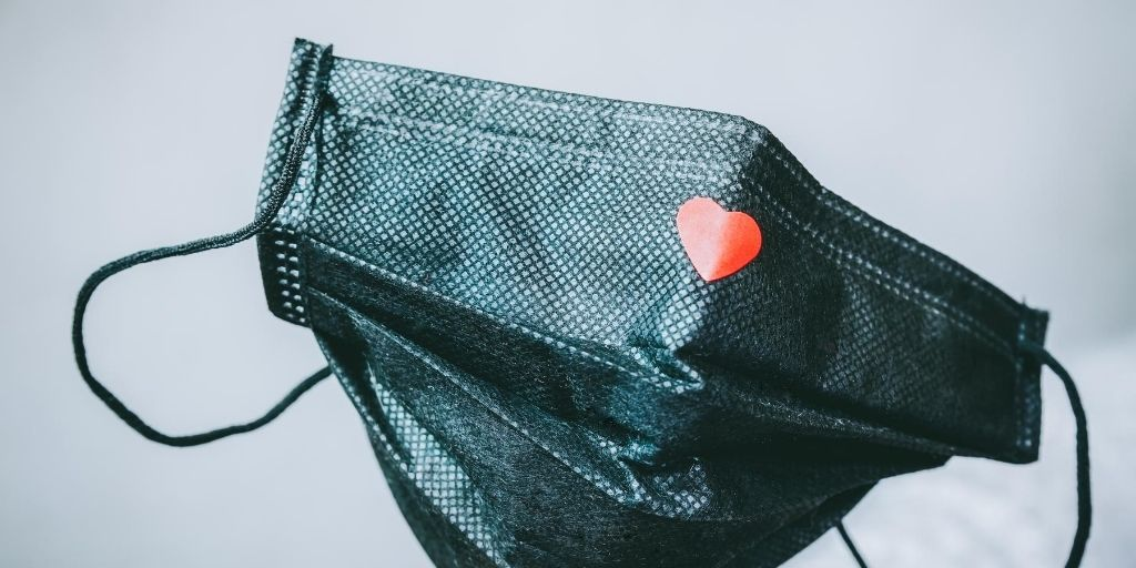 An illustration of a face mask with a heart on it for our COVID-19 Policy page