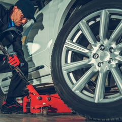 Changing you seasonal tires at home - floor jack.