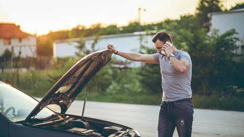 Roadside assistance: this motorist cannot start his vehicle and needs a battery boost service to assist him.