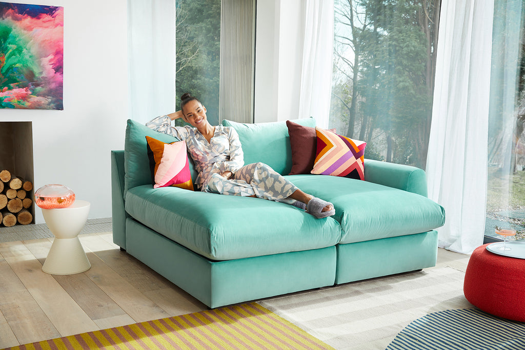 Girl sitting on Snug's The Cloud Sundae Chaise Lounge Sofas