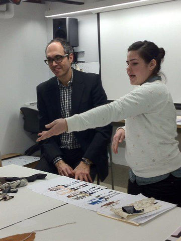 Drexel University student presents her jewelry collection to John Wind