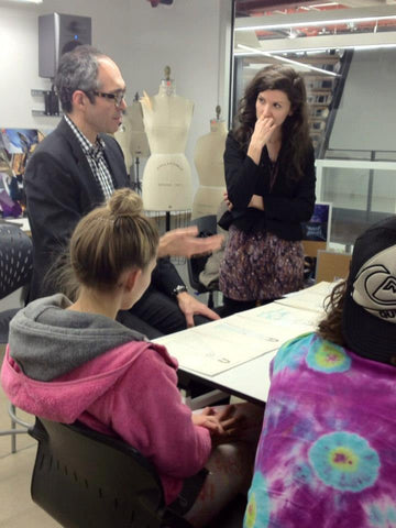John Wind discussing jewelry and accessories with Drexel University Students