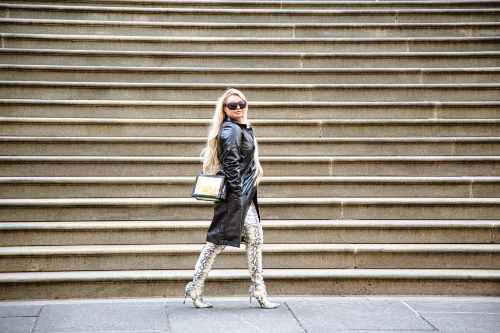 Photo of Jessica Robinson walking in front of wall of stairs in New York, photo by Michael Dickinson