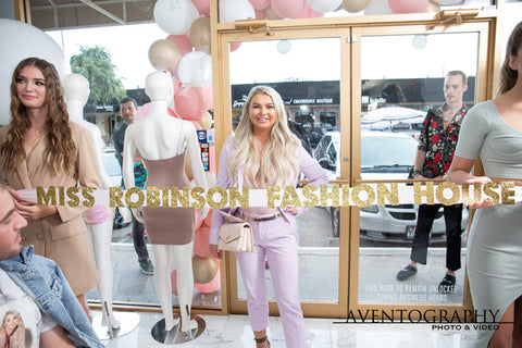 Jessica Robinson ribbon cutting at grand opening of Miss Robinson Fashion House