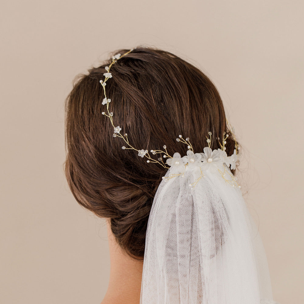 hair vine pinned over wedding veil