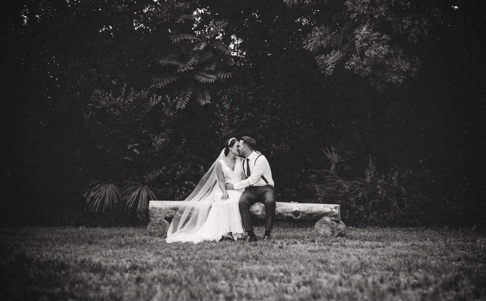 black and white wedding veil on bench