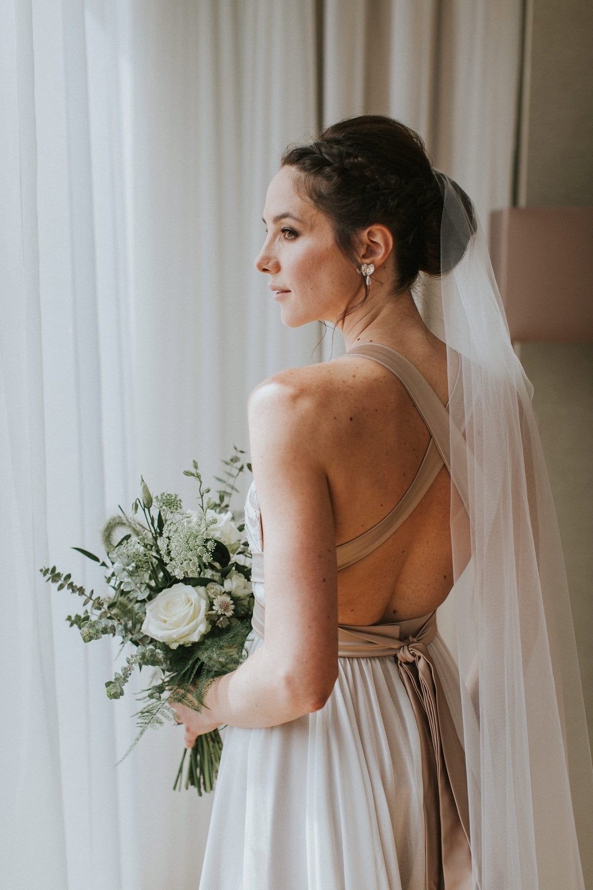 silver earrings and barely there veil