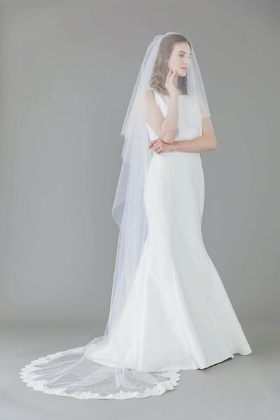 Two tier wedding veil with lace around the train