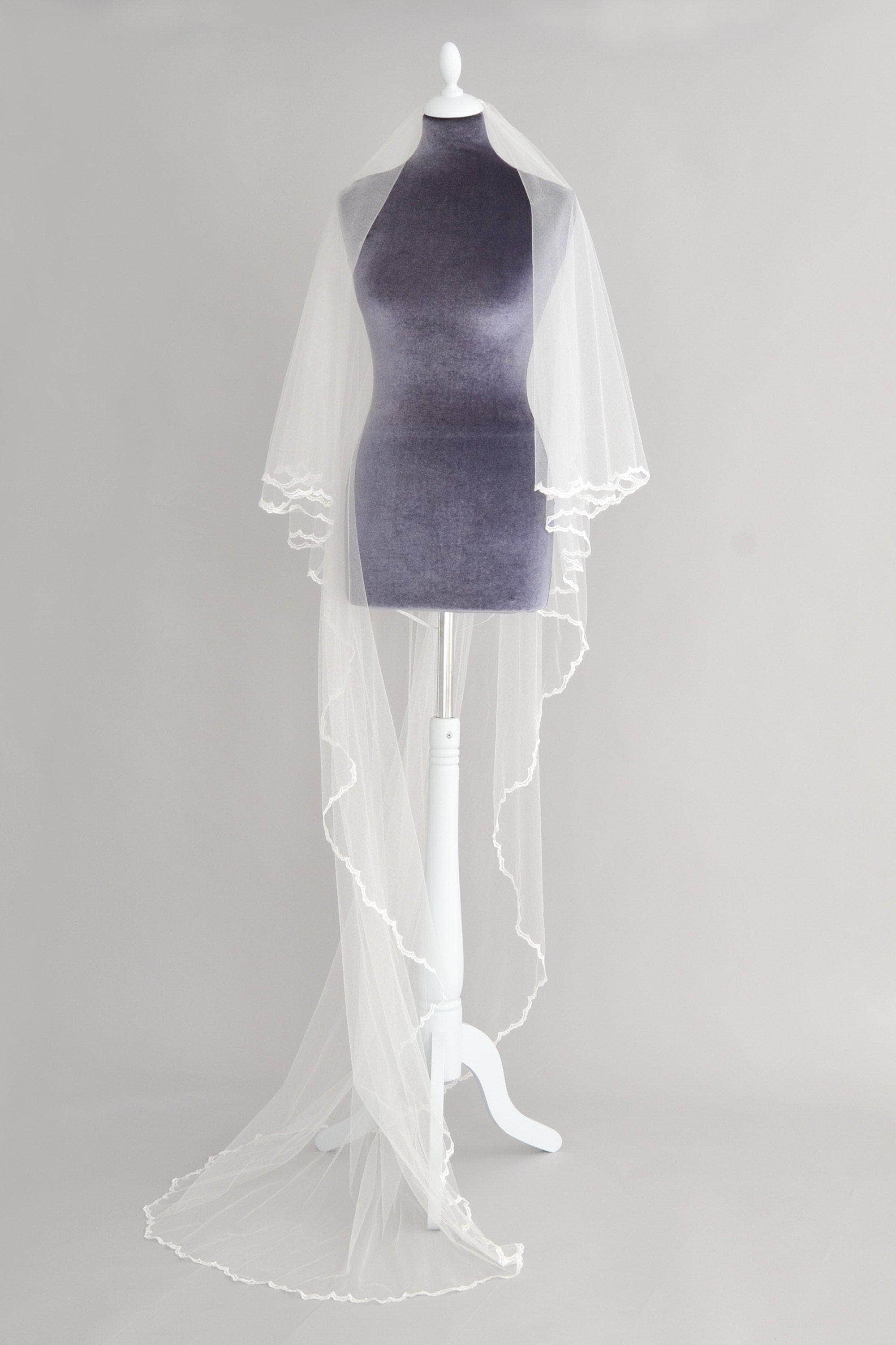 crisp silk two tier wedding veil with delicate lace edge